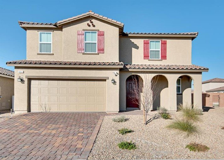 two-story home with 3 arches at porch and red shutters in NLV NV